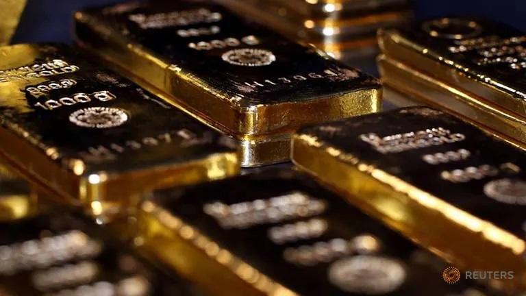 Gold hits a high, more precious as dollar loses value